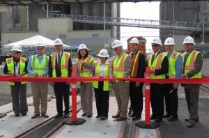 Left to right: Shari Hildreth, Office of U.S. Rep. Herrera Beutler; David Hodges, Office of U.S. Sen. Murray;	Port Commissioner Jerry Oliver; U.S. Sen. Cantwell; Port Commission President Nancy Baker; Port Commissioner Brian Wolfe; Port CEO Todd Coleman; Johan Hellman, BNSF Railway; WSDOT Southwest Regional Administrator Kris Strickler; Great Western Malting Commercial Director Brad Loucks